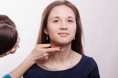 Makeup artist gets fluffy powder brush on forehead model Royalty Free Stock Photos