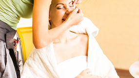 Makeup artist glues eyelashes. Beautiful woman Stock Photography