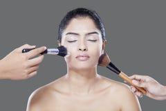 Makeup artist hands applying makeup Royalty Free Stock Photography