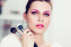 The makeup artist holds powder brushes Stock Photo