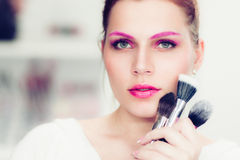 The makeup artist holds powder brushes Royalty Free Stock Photography