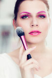 The makeup artist holds rouge brush Stock Photography