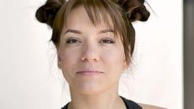 Makeup artist makes makeup of a beautiful young caucasian brunette. stock video footage