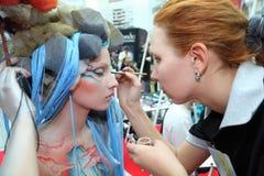 Makeup artist makes body art for model Royalty Free Stock Image