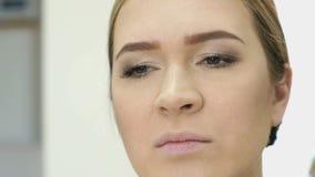 Makeup artist making make-up for stylish model stock video