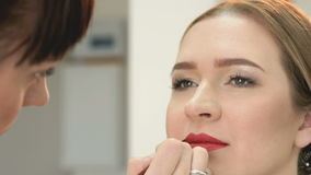 Makeup artist making make-up for stylish model stock video footage