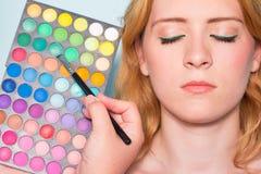 Makeup artist paints a eyes of woman. Makeup. Stock Image