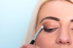 Makeup artist paints a eyes of woman. Makeup. Royalty Free Stock Photos