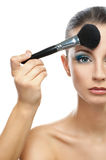 Makeup artist prepares forehead Royalty Free Stock Photos