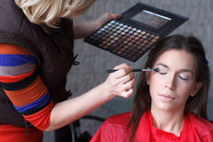 Makeup artist preparing eyeshadow stock photos