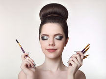 Makeup artist. Pretty teen girl with cute bun hairstyle and fash Royalty Free Stock Image