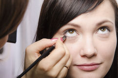 Makeup artist in the process of makeup colors eyelashes model Royalty Free Stock Photos