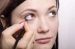 Makeup artist in the process of makeup colors eyelashes model Royalty Free Stock Images