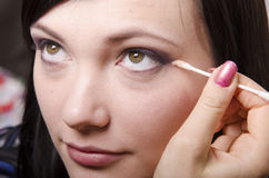 Makeup artist in the process of makeup colors eyelids model Stock Photos