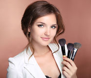Makeup artist professional stylist woman holding brushes in hand Royalty Free Stock Photos