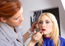 Makeup artist and red lipstick Stock Photos