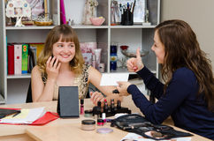 Makeup artist satisfied with results of client to consult Royalty Free Stock Images