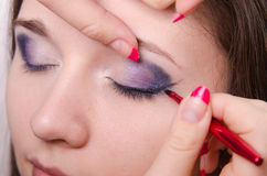 Makeup artist starts causing arrows forever models Stock Photos