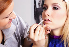 Makeup artist tracing contour on the lips Royalty Free Stock Image