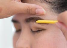 Makeup artist used eyebrow razor makeup Stock Image