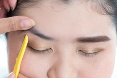 Makeup artist used eyebrow razor makeup Stock Photo