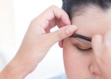 Makeup artist used eyebrow scissors makeup Royalty Free Stock Photography