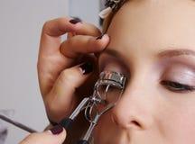 A makeup artist wave the eyelashes