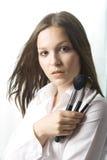 Makeup artist, on white background. Beautiful young makeup artist with some brushes on white background Stock Photos
