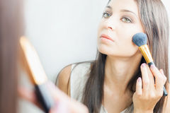 Makeup artist woman doing make-up using cosmetic brush for yourself Stock Photo