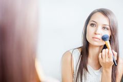 Makeup artist woman doing make-up using cosmetic brush for yourself Stock Photography
