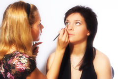Makeup artist at work Royalty Free Stock Photos
