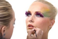 Makeup artist at work. Isolated ower white Royalty Free Stock Images