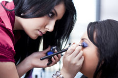 Makeup artist at work Stock Photo
