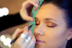 Makeup artist at work Royalty Free Stock Photos