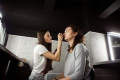 Makeup artist at work. Backstage photo of makeup artist at work Royalty Free Stock Photos