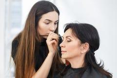 Makeup artist work in beauty salon Stock Photos