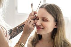 Makeup artist at work with a client Royalty Free Stock Photo