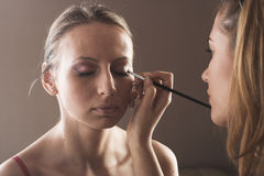 Makeup artist at work. Close-up studio portrit of a makeup artist at work Royalty Free Stock Photography