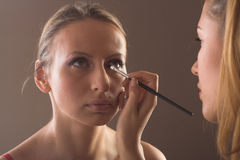 Makeup artist at work. Close-up studio portrit of a makeup artist at work Royalty Free Stock Images