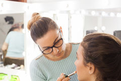 Makeup artist at work in the studio Royalty Free Stock Photo