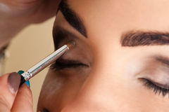 Makeup artist working Royalty Free Stock Photos