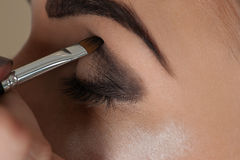 Makeup artist working with the eye Stock Photo