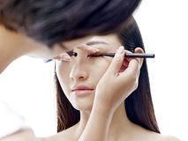 Makeup artist working on  female model Stock Photography
