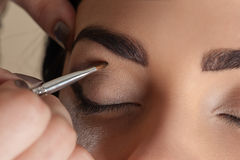 Makeup artist working make-up brush Royalty Free Stock Images