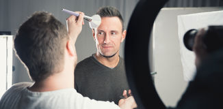 Makeup artist working on models face Royalty Free Stock Images