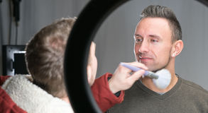 Makeup artist working on models face Stock Photos