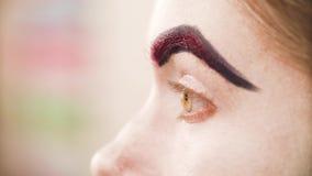 Makeup artysty kolorystyki czerwona brew model zdjęcie wideo