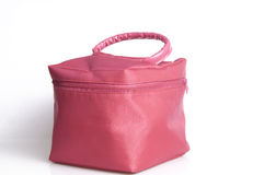 Makeup bag .... Feminine looking baggage in pink Stock Photos