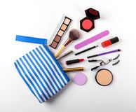 Makeup bag with cosmetics on white background Stock Images