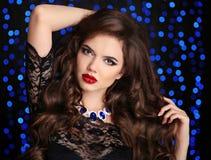 Makeup. Beautiful brunette woman portrait. Fashion jewelry. Royalty Free Stock Photos